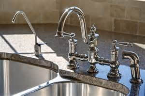 chrome faucet sink granite counter-top